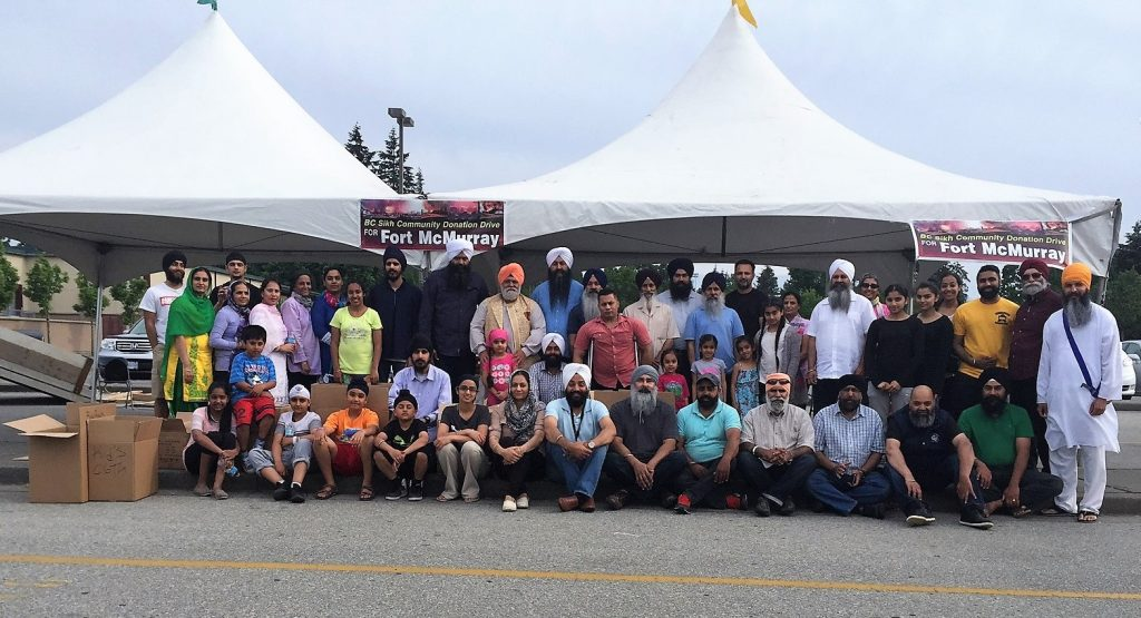 Fort McMurray - BC Sikh Community fills 5 More Trucks/Trailers in One Day for Alberta Fire Victims
